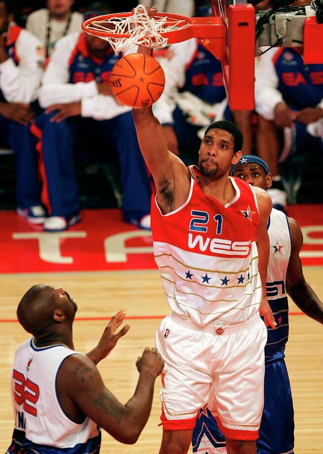 The Spurs' Tim Duncan snaps the net as the dunks a shot over Miami's Shaquille O'Neal and Cleveland's Lebron James in the first half of the 2006 NBA All-Star Game at the Toyota Center in Houston on Sunday, Feb. 19, 2006. Photo: KIN MAN HUI, SAN ANTONIO EXPRESS-NEWS / SAN ANTONIO EXPRESS-NEWS