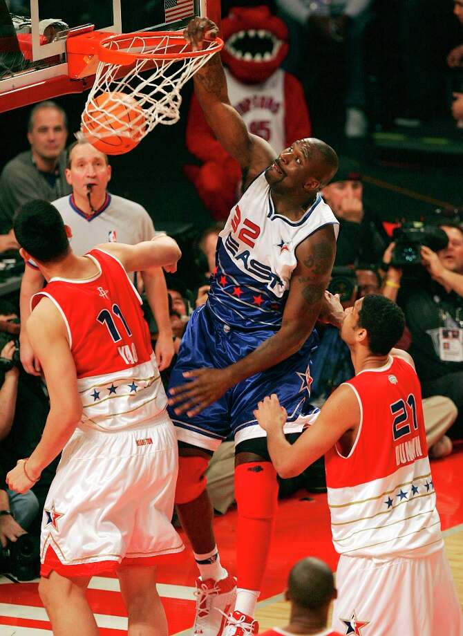 Miami Heat's Shaquille O'Neal slams dunks over Houston's Yao Ming and Spurs' Tim Duncan in the first half of the 2006 NBA All-Star game at the Toyota Center in Houston on Sunday, Feb. 19, 2006. Photo: KIN MAN HUI, SAN ANTONIO EXPRESS-NEWS / SAN ANTONIO EXPRESS-NEWS