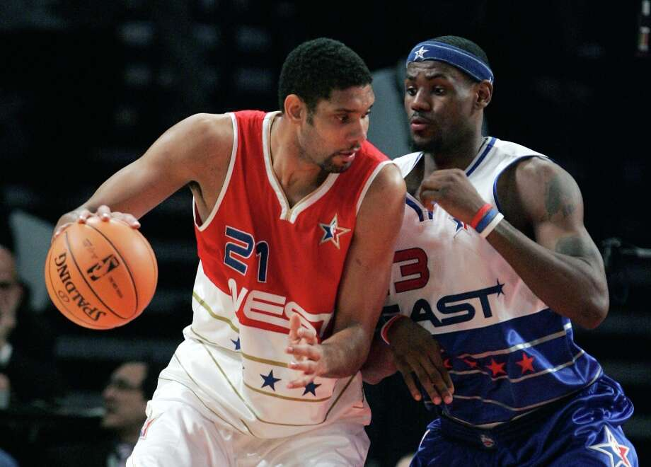West All-Star Tim Duncan collides with East All-Star LeBron James during the fourth quarter of the NBA All-Star Game in Houston, Sunday, Feb. 19, 2006. The East defeated the West 122-120. Photo: LM OTERO, AP / AP