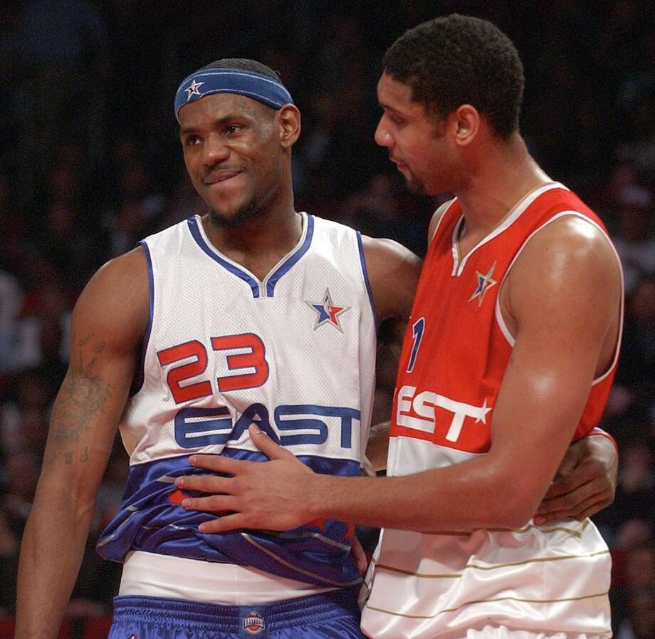 The Cavaliers' Lebron James and Spurs' Tim Duncan talk during the NBA All-Star game Sunday Feb. 19, 2006 in Houston, TX. The East went on to win 122-120, and James was named game MVP. Photo: EDWARD A. ORNELAS, SAN ANTONIO EXPRESS-NEWS / SAN ANTONIO EXPRESS-NEWS