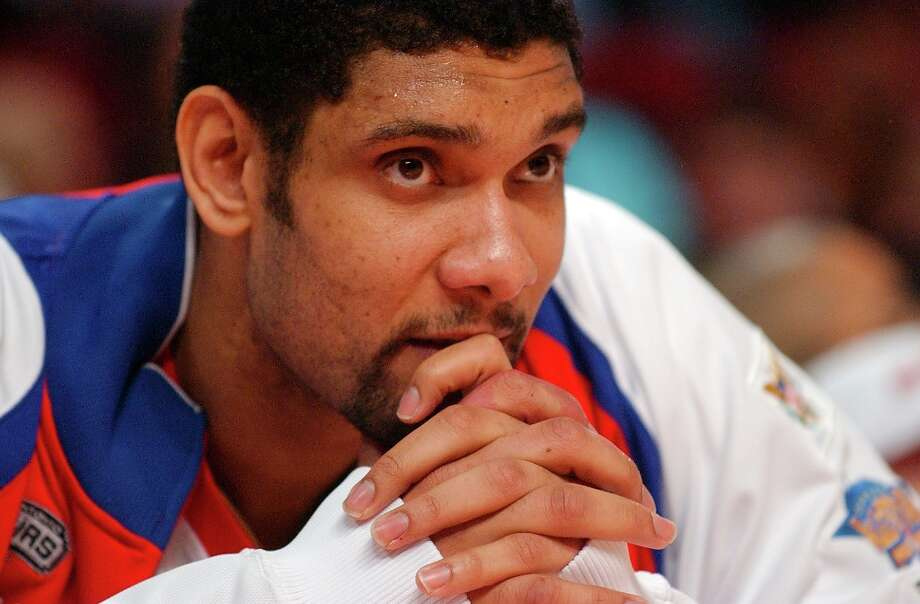 The Spurs' Tim Duncan watches action from the bench during the NBA All-Star game Sunday Feb. 19, 2006 in Houston, TX. The East went on to win 122-120. Photo: EDWARD A. ORNELAS, SAN ANTONIO EXPRESS-NEWS / SAN ANTONIO EXPRESS-NEWS