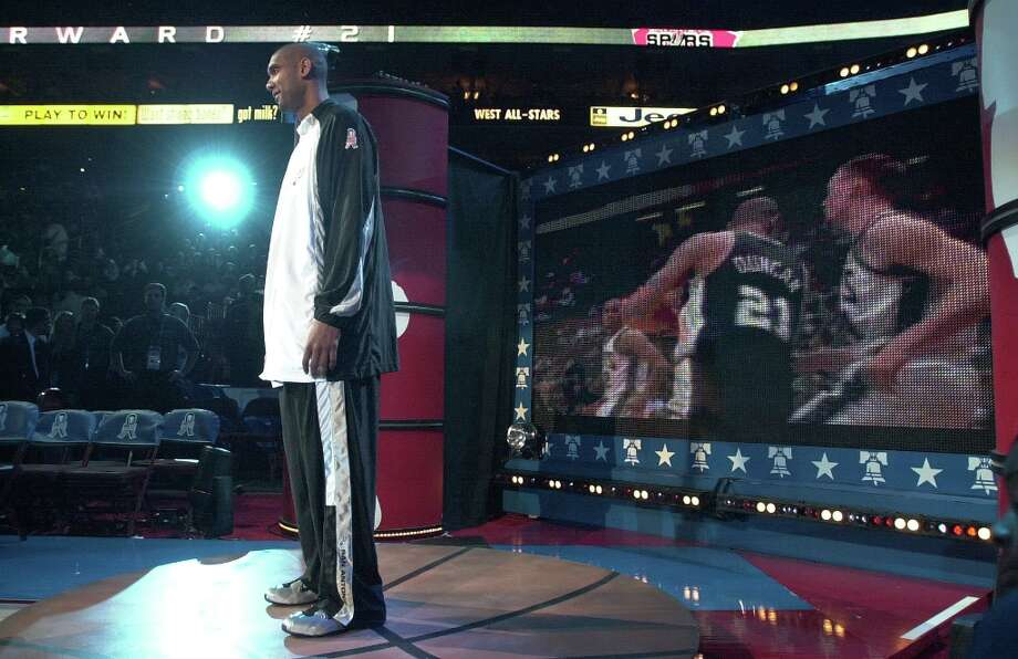 The Spurs' Tim Duncan (21) stands in the spotlight as the Western Conference players are introduced during the 2002 NBA All-Star Game and the Union Center in Philadelphia on Sunday, Feb. 10, 2002. Photo: KIN MAN HUI, SAN ANTONIO