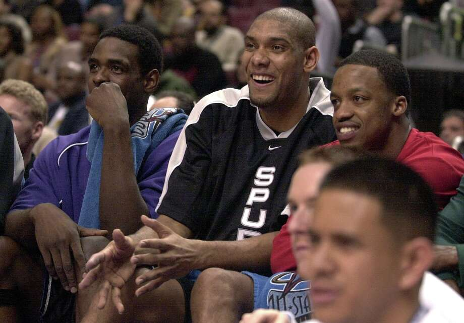 The Spurs' Tim Duncan (center) reacts to a play on court with Western Conference All-Star teammates Chris Webber (left) and Steve Francis (right) during the 2002 NBA All-Star Game at the Union Center in Philadelphia on Sunday, Feb. 10, 2002. Photo: KIN MAN HUI, SAN ANTONIO