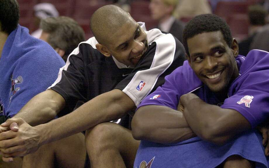The Spurs' Tim Duncan (center) shares a laugh with Western Conference All-Star teammate Chris Webber of the Sacramento Kings during the 2002 NBA All-Star Game at the Union Center in Philadelphia on Sunday, Feb. 10, 2002. Photo: KIN MAN HUI, SAN ANTONIO