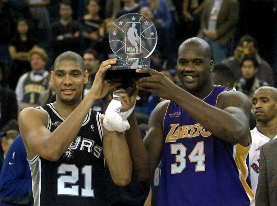 Co-MVPs and Western Conference teammates Tim Duncan (21) of the Spurs, and Shaquille O'Neal (34) of the Lakers hold the MVP trophy after the NBA All-Star Game in Oakland, Calif., Sunday, Feb. 13, 2000. The West beat the East 137-126. Photo: BOB GALBRAITH, AP / AP