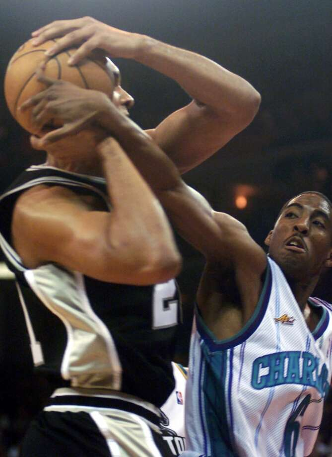 Eastern conference all star Eddie Jones, right, of the Charlotte Hornets, battles Western Conference all star Tim Duncan, of the Spurs, for the ball during the NBA All-Star Game in Oakland, Calif., Sunday, Feb. 13, 2000. Photo: BOB GALBRAITH, AP / AP