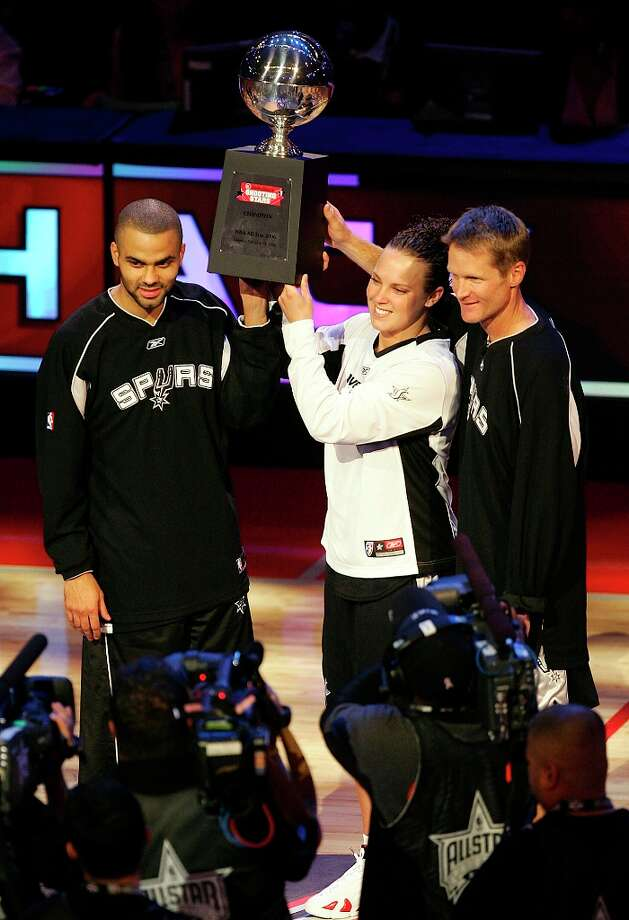 Spurs guard Tony Parker (from left), Silver Stars forward Kendra Wecker and former Spurs guard Steve Kerr hold up the RadioShack Shooting Competition trophy after defeating three other trio of teams with a record time of 25.1 seconds at the NBA All-Star Saturday Night event at the Toyota Center in Houston on Saturday, Feb. 18, 2006. (Kin Man Hui/staff) Photo: KIN MAN HUI, SAN ANTONIO EXPRESS-NEWS / SAN ANTONIO EXPRESS-NEWS