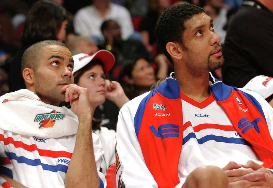 FOR SPORTS - Spurs' Tony Parker and Tim Duncan relax on the bench during the NBA All-Star game Sunday Feb. 19, 2006 in Houston, TX. PHOTO BY EDWARD A. ORNELAS/STAFF Photo: EDWARD A. ORNELAS, SAN ANTONIO EXPRESS-NEWS / SAN ANTONIO EXPRESS-NEWS
