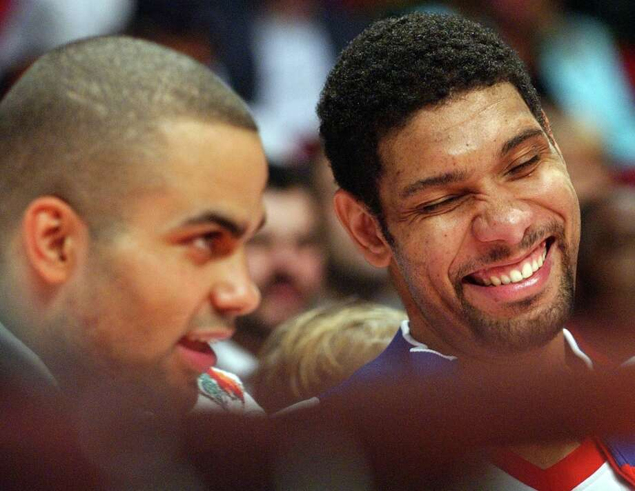 Spurs' Tony Parker and Tim Duncan joke on the bench during the NBA All-Star game Sunday Feb. 19, 2006 in Houston, TX. PHOTO BY EDWARD A. ORNELAS/STAFF Photo: EDWARD A. ORNELAS, SAN ANTONIO EXPRESS-NEWS / SAN ANTONIO EXPRESS-NEWS