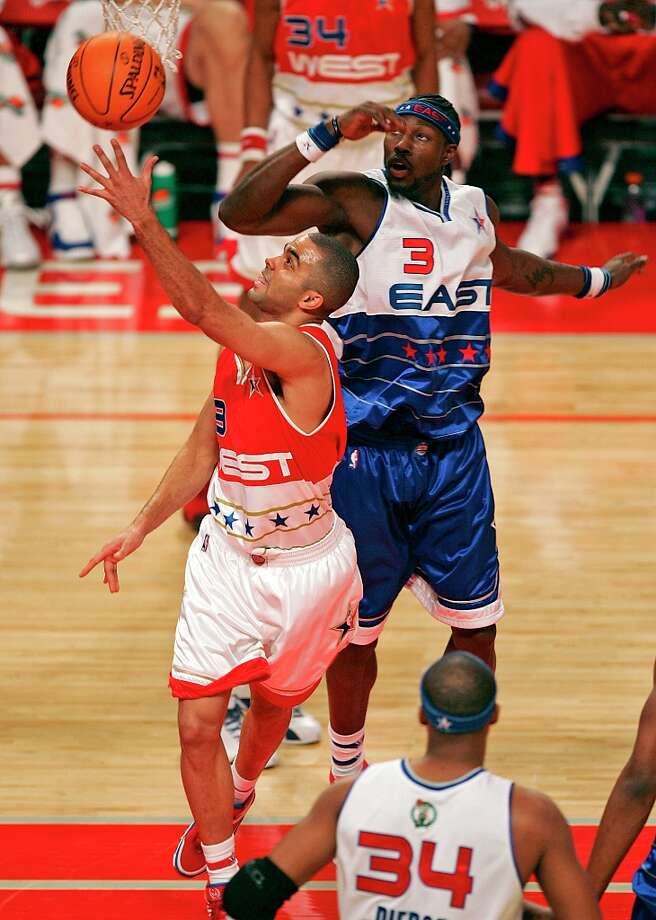 SPORTS - Spurs' Tony Parker goes for a basket past Detroit's Ben Wallace in the second half of the 2006 NBA All-Star Game at the Toyota Center in Houston on Sunday, Feb. 19, 2006. The East All-Stars defeated the West All-Stars, 122-120. (Kin Man Hui/staff) Photo: KIN MAN HUI, SAN ANTONIO EXPRESS-NEWS / SAN ANTONIO EXPRESS-NEWS