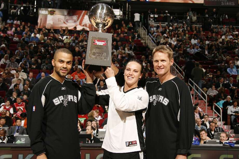 (L-R) Tony Parker of the San Antonio Spurs, Kendra Wecker of the San Antonio Silver Stars and Former San Antonio Spurs guard Steve Kerr celebrate with the trophy after winning the Radio Schack Shooting Stars competition on All-Star Saturday Night during 2006 All-Star Weekend February 18, 2006 at the Toyota Center in Houston, Texas. NOTE TO USER: User expressly acknowledges and agrees that, by downloading and or using this photograph, user is consenting to the terms and conditions of the Getty Images License Agreement. Mandatory Copyright Notice: Copyright 2006 NBAE Photo: Nathaniel S. Butler, NBAE/Getty Images / 2006 NBAE