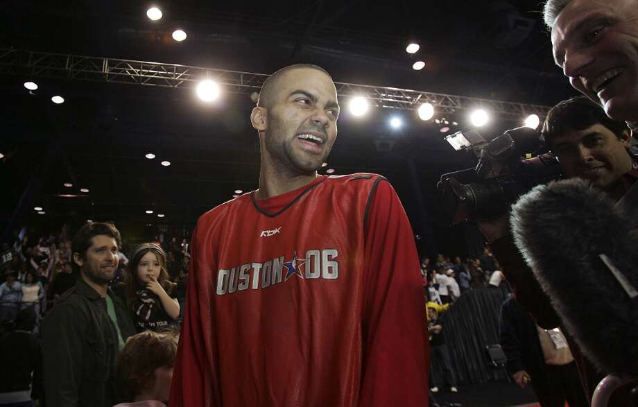 Spurs guard and All-Star reserve Tony Parker laughs during media interviews prior the open practice session at NBA All-Star's Jam Session at the George R. Brown Convention Center in Houston on Saturday, Feb. 18, 2006. (Kin Man Hui/staff) Photo: KIN MAN HUI, SAN ANTONIO EXPRESS-NEWS / SAN ANTONIO EXPRESS-NEWS