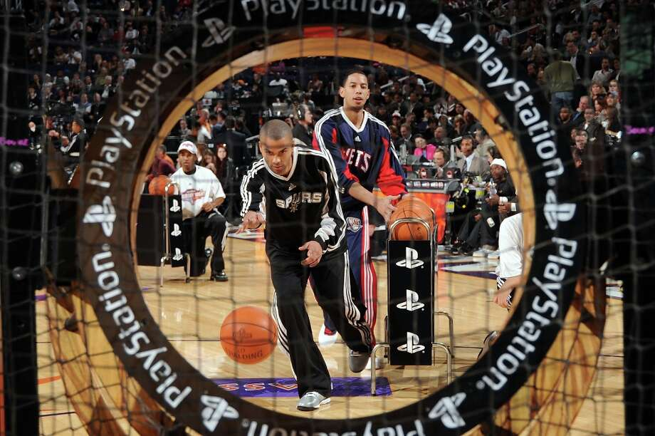 Tony Parker of the Spurs and Devin Harris (34) of the Nets participate in the Play Station Skills Challenge on All-Star Saturday Night, part of 2009 NBA All-Star Weekend at US Airways Center on Feb. 14, 2009 in Phoenix, Arizona. Photo: Andrew D. Bernstein, NBAE/Getty Images / 2009 NBAE