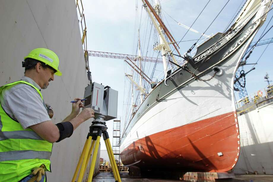 Richard Lasater, president of  SmartGeoMetrics, uses a Leica HDS7000 laser scanner to produce a 3D representation of Elissa in dry dock at Bollinger Shipyards. Photo: Melissa Phillip, Houston Chronicle / © 2013 Houston Chronicle