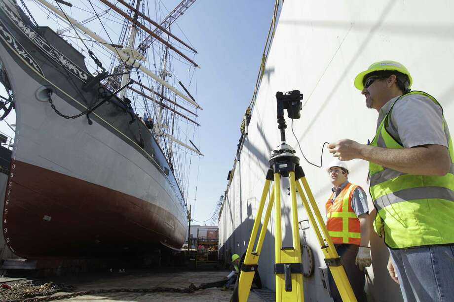 Travis Davis, left, maintenance supervisor for Battleship Texas, watches as Richard Lasater, right, president of SmartGeoMetrics, takes photos to document color as part of his laser scanning work to produce a 3D representation of Elissa. Photo: Melissa Phillip, Houston Chronicle / © 2013 Houston Chronicle