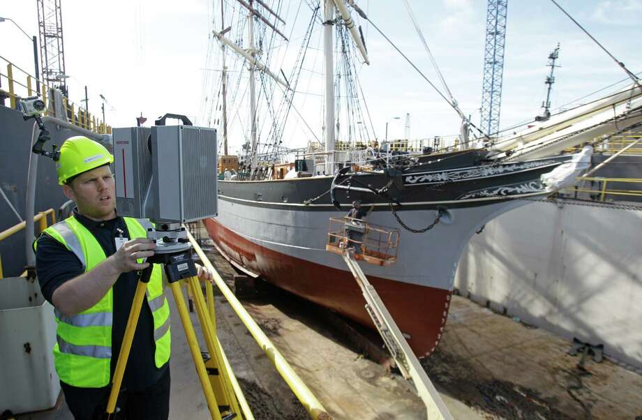 Nicholas Boccio, chief technologist of  SmartGeoMetrics, uses a Leica HDS7000 laser scanner to produce a 3D representation of Elissa in dry dock at Bollinger Shipyards. Photo: Melissa Phillip, Houston Chronicle / © 2013 Houston Chronicle