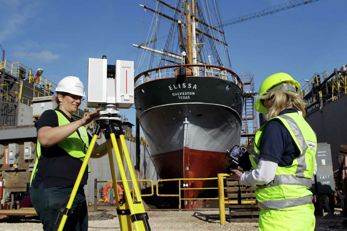 Barbara Misto, left, logistics manager of SmartGeoMetrics, and Virginia Morrill, chief technologist, use a Leica HDS7000 laser scanner to produce a 3D representation of Elissa in dry dock at Bollinger Shipyards.