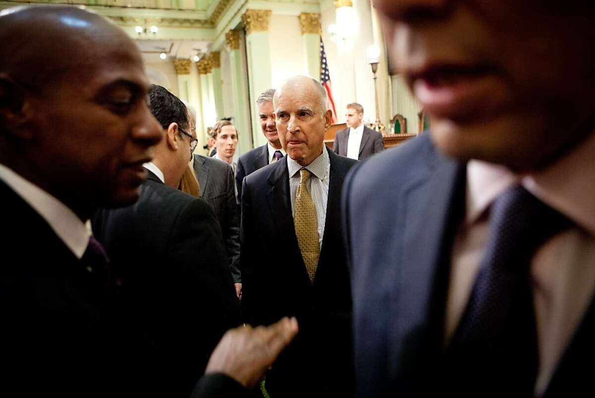 Gov. Jerry Brown leaves the Assembly Chambers after delivering his State of the State address at the State Capitol January 24, 2013 in Sacramento, Calif.