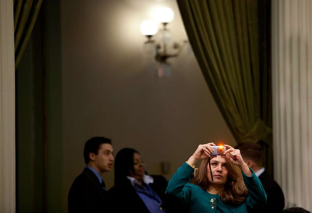 Assembly Member Sharon Quirk-Silva takes a photograph in the Assembly Chambers before Gov. Jerry Brown gives his State of the State address at the State Capitol January 24, 2013 in Sacramento, Calif.