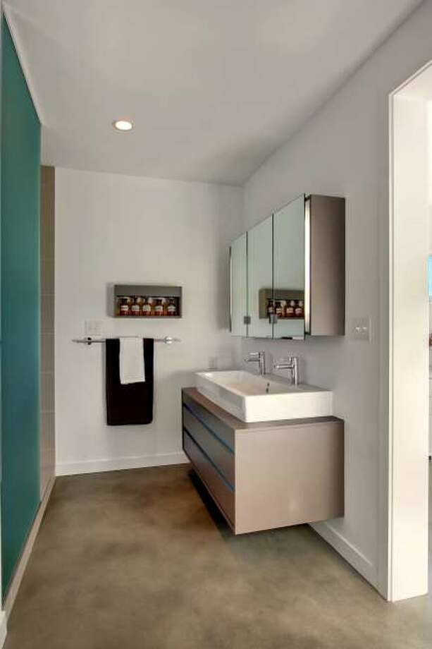 Bathroom of 3208 44th Ave. W. The 3,496-square-foot house, built in 2012, has five bedrooms, 3.5 bathrooms, walls of windows, a den/office, a family room, a bar, concrete floors, a rooftop deck, a front porch, a patio, views of Puget Sound and the Olympic Mountains and a two-car garage on a 5,800-square-foot lot. It's listed for $1.575 million. Photo: Vista Estate Imaging/Courtesy Enrico Pozzo/Coldwell Banker Bain