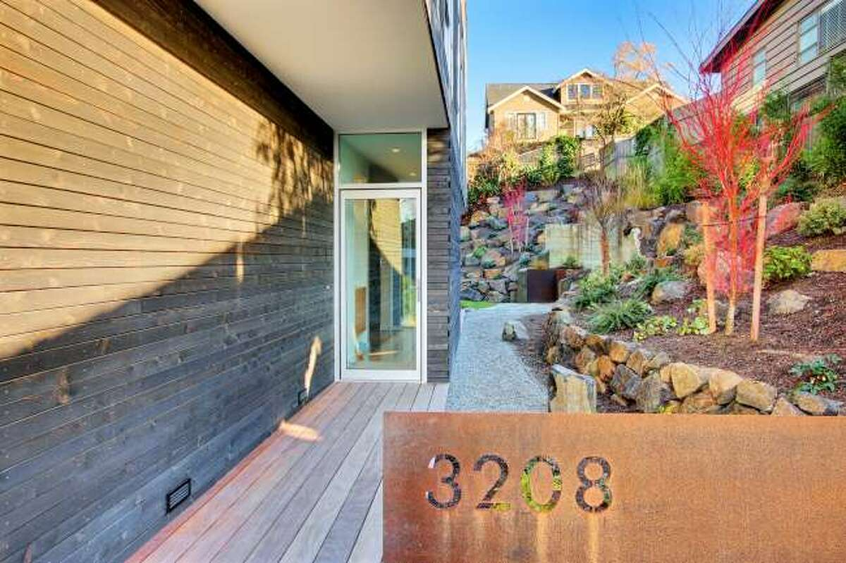 Front of 3208 44th Ave. W. The 3,496-square-foot house, built in 2012, has five bedrooms, 3.5 bathrooms, walls of windows, a den/office, a family room, a bar, concrete floors, a rooftop deck, a front porch, a patio, views of Puget Sound and the Olympic Mountains and a two-car garage on a 5,800-square-foot lot. It's listed for $1.575 million.