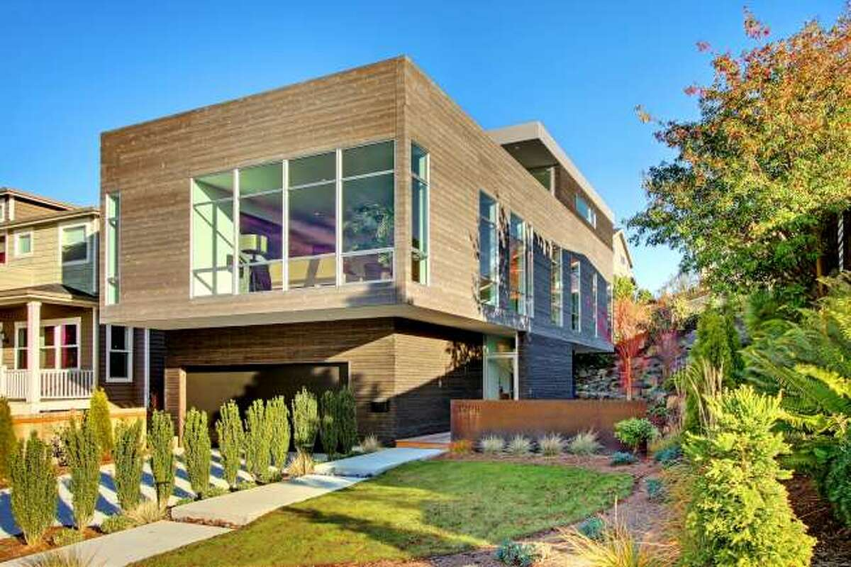 Looking for a green contemporary home with lots of space in Magnolia? Check out 3208 44th Ave. W. The 3,496-square-foot house, built in 2012, has five bedrooms, 3.5 bathrooms, walls of windows, a den/office, a family room, a bar, concrete floors, a rooftop deck, a front porch, a patio, views of Puget Sound and the Olympic Mountains and a two-car garage on a 5,800-square-foot lot. It's listed for $1.575 million.