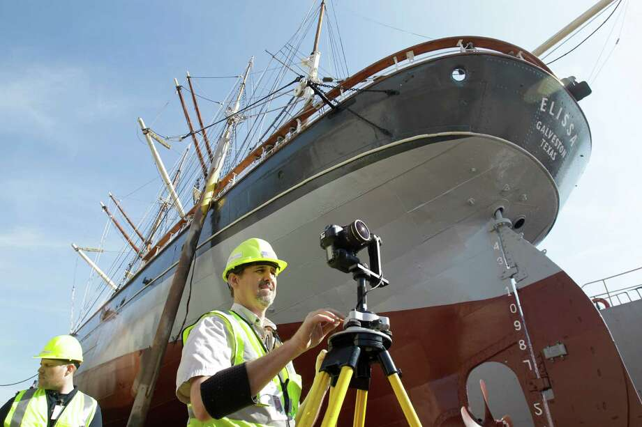 Richard Lasater, right, president of  SmartGeoMetrics, takes photos to document color as part of laser scanning work to produce a 3D representation of Elissa in dry dock at Bollinger Shipyards, Thursday, Jan. 24, 2013, in Texas City. The Elissa is a three-masted, iron-hulled sailing ship built in 1877. The Elissa will return on Saturday to the Texas Seaport Museum in Galveston. Photo: Melissa Phillip, Houston Chronicle / © 2013 Houston Chronicle