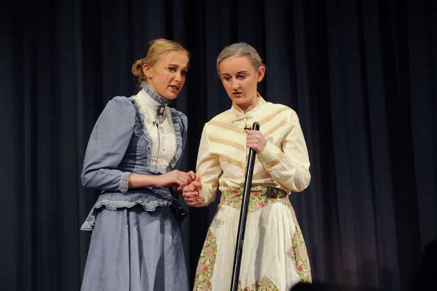 Katie Hoffmeister as Marian Paroo, left, and Katherine Tracey as Mrs. Paroo during âÄúThe Music ManâÄù at the Eastern Middle School School in Riverside, Conn., Thursday, Jan. 24, 2013. The show continues Friday and Saturday at 7:30 p.m. at the school, 51 Hendrie Ave. Tickets will be on sale in the main lobby before school. Tickets are $15 each for the Friday and Saturday evening performances.30 p.m. at the school, 51 Hendrie Ave. Tickets will be on sale in the main lobby before school. Tickets are $5 each for the Thursday performance and $15 each for the Friday and Saturday evening performances. Photo: Helen Neafsey / Greenwich Time