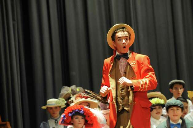 "Peter Bound as Harold Hill during ""The Music Man"" at the Eastern Middle School School in Riverside, Conn., Thursday, Jan. 24, 2013. The show continues Friday and Saturday at 7:30 p.m. at the school, 51 Hendrie Ave. Tickets will be on sale in the main lobby before school. Tickets are $15 each for the Friday and Saturday evening performances.30 p.m. at the school, 51 Hendrie Ave. Tickets will be on sale in the main lobby before school. Tickets are $5 each for the Thursday performance and $15 each for the Friday and Saturday evening performances. Photo: Helen Neafsey / Greenwich Time"