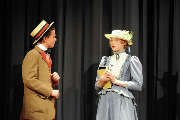 Peter Bound, as Harold Hill, and Katie Hoffmeister as Marian Paroo during âÄúThe Music ManâÄù at the Eastern Middle School School in Riverside, Conn., Thursday, Jan. 24, 2013. The show continues Friday and Saturday at 7:30 p.m. at the school, 51 Hendrie Ave. Tickets will be on sale in the main lobby before school. Tickets are $15 each for the Friday and Saturday evening performances.30 p.m. at the school, 51 Hendrie Ave. Tickets will be on sale in the main lobby before school. Tickets are $5 each for the Thursday performance and $15 each for the Friday and Saturday evening performances. Photo: Helen Neafsey / Greenwich Time