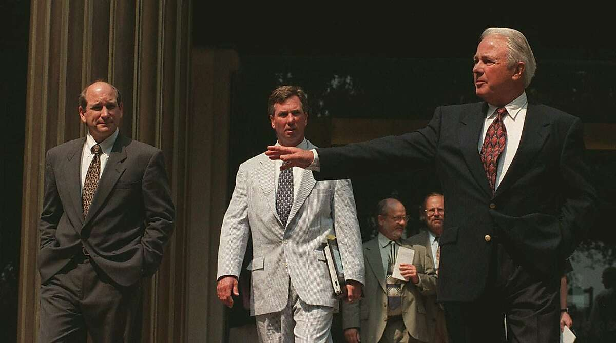 Former Louisiana Gov. Edwin Edwards, right, tells his son Stephen Edwards, left, and Stephen's attorney Lewis Unglesby, center, that he will be with them after he answers reporters questions on the Federal Courthouse steps Friday, Aug. 29, 1997 in Baton Rouge, La. Edwards talked about his almost $500, 000 that was seized by the FBI earlier this year. Federal Judge John Parker is slated to hold an in-chambers meeting with the FBI to view evidence as to why the money shouldn't be released. Gambling investigation case and fraud involving Edddie DeBartolo Jr. also. (AP Photo/BillFeig)