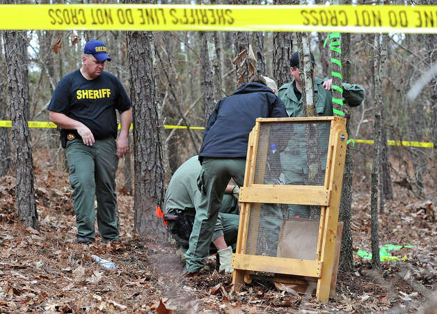 A Texas Ranger and Jasper County deputies search an area Thursday in where several bones and a man's skull were recently found. The skull is said to belong to a man who has yet to be identified, but an investigation is underway. It is unknown at this point if the other bones are human.  Photo taken Thursday, January 23, 2013 Guiseppe Barranco/The Enterprise Photo: Guiseppe Barranco, STAFF PHOTOGRAPHER / The Beaumont Enterprise