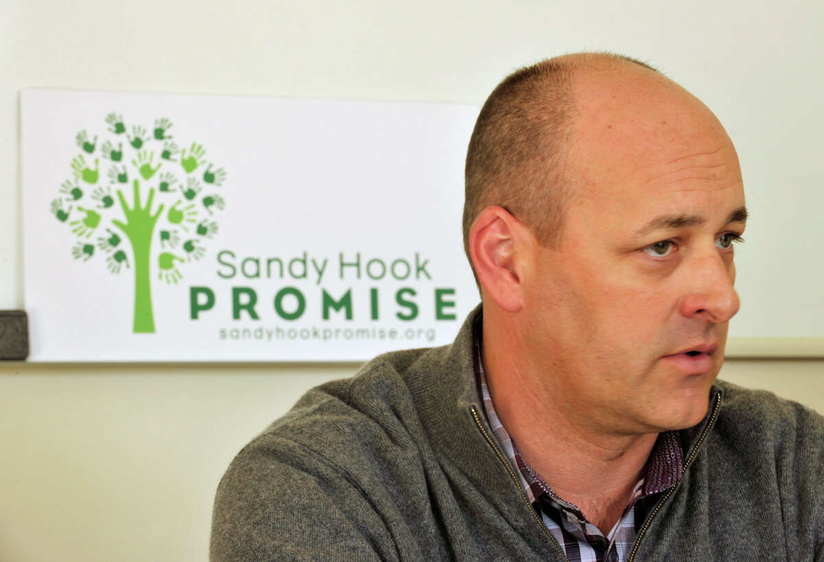 James Belden, co-founder and executive committee member of Sandy Hook Promise, speaks during a meeting in the organization's offices in Newtown on Thursday, Jan. 24, 2013.