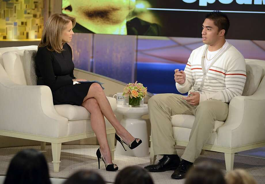 "In this photo taken on Jan. 22, 2013 and released by ABC Notre Dame linebacker Manti Te'o, right, speaking with host Katie Couric during an interview for ""Katie,"" in New York. Te'o has told Couric that he briefly lied about his online girlfriend after discovering she didn't exist, while maintaining that he had no part in creating the hoax. The interview will air on Thursday, Jan. 24.  (AP Photo/Disney-ABC, Lorenzo Bevilaqua) Photo: Lorenzo Bevilaqua, Associated Press"