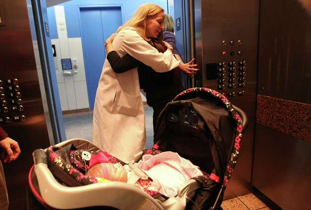 Texas Children's Pediatric Cardiologist Dr. Carrie Altman embraces Ashley Cardenas they day her daughter Audrina Cardenas, 3 months, is discharged from the hospital. Dr. Altman will be in charge of Audrina's long term care. Photo: Mayra Beltran, Houston Chronicle / © 2013 Houston Chronicle