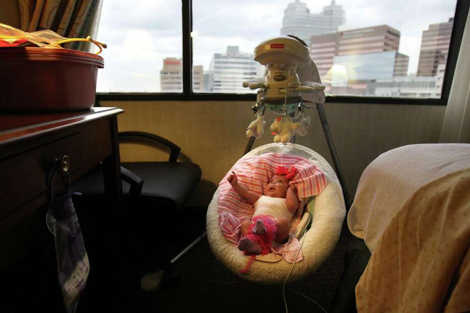 Audrina Cardenas, 3 months, settles into her new space near the medical center. Photo: Mayra Beltran, Houston Chronicle / © 2013 Houston Chronicle