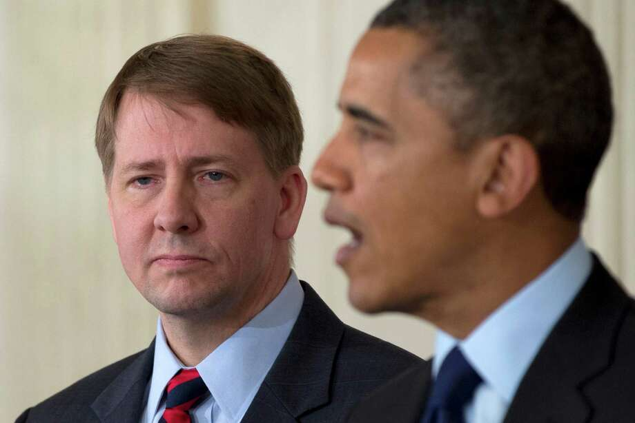 Richard Cordray stands left as President Barack Obama announces in the State Dining Room of the White House in Washington, Thursday, Jan. 24, 2013, that he will re-nominate Cordray to lead the Consumer Financial Protection Bureau, a role that he has held for the last year under a recess appointment, and nominate Mary Joe White to lead the Security and Exchange Commission (SEC).  (AP Photo/Carolyn Kaster) Photo: Carolyn Kaster