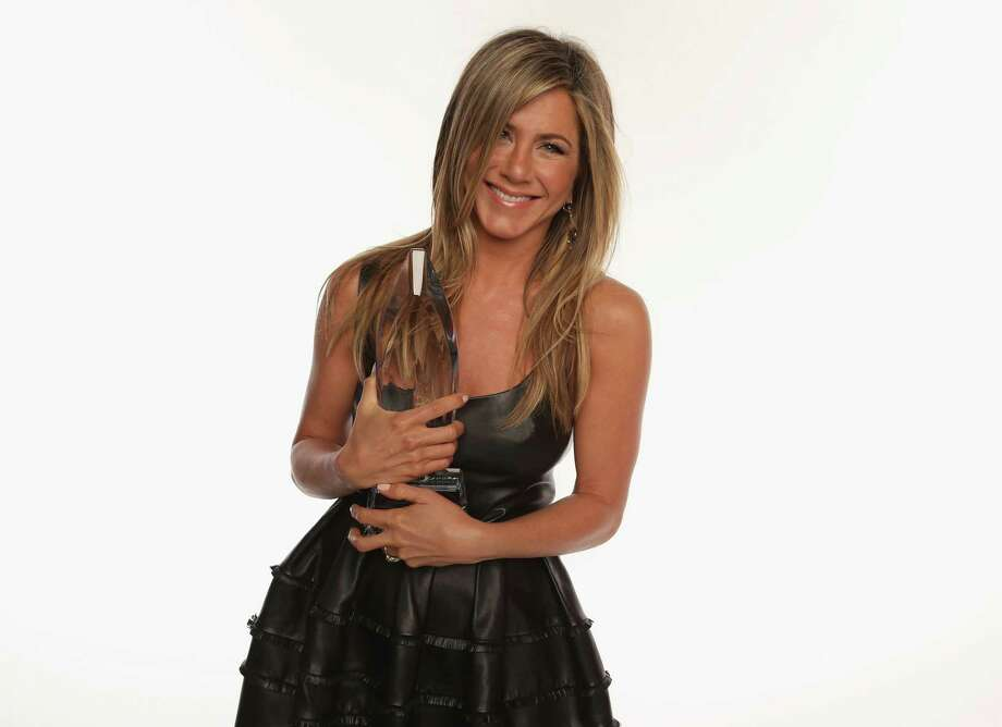 Actress Jennifer Aniston poses for a portrait during the 39th Annual People's Choice Awards at Nokia Theatre L.A. Live on January 9, 2013 in Los Angeles, California. The Greenwich Board of Selectmen approved a one-day intermittent road closure on Hamilton Avenue on Feb. 11 to allow an independent movie starring Jennifer Aniston to shoot a scene at the Two Door Bar in Greenwich, Conn. Photo: Christopher Polk, Photo By Christopher Polk/Getty Images For PCA / 2013 Getty Images