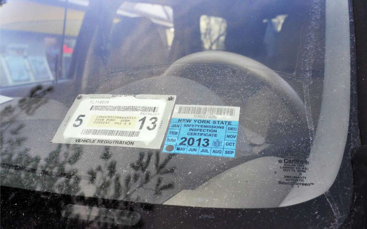 NYS registration and inspection stickers on a car in Colonie Jan. 22, 2013. (John Carl D'Annibale / Times Union)