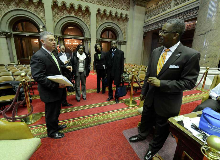 Assemblyman John McDonald, left, of the 108th A.D. gives a tour of the Assembly Chamber to a contingent of Kenyan politicians, Thursday Jan. 24, 2013, in Albany N.Y. Assembly Sergeant at arms Wayne P. Jackson, is pictured at right. (Skip Dickstein/Times Union) Photo: SKIP DICKSTEIN