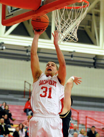 Sacred Heart's #31 Steve Glowiak tries to score, during men's basketball action against Bryant at Sacred Heart University in Fairfield, Conn. on Thursday January 24, 2013. Photo: Christian Abraham / Connecticut Post