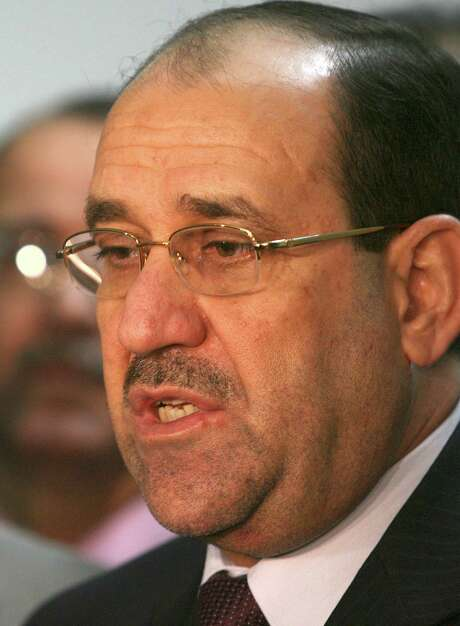 "**  FILE ** Iraq's Prime Minister Nouri al-Maliki, right, speaks  during a press conference in Baghdad in this Oct. 3, 2007 file photo. Al-Maliki flew to London Saturday Dec. 29, 2007 for what one of his advisers described as a regularly scheduled medical checkup. Al-Maliki told Iraqiyah TV at Baghdad airport that he had for some time wanted to have a checkup and ""it became convenient now.""  (AP Photo/Hadi Mizban, File) Photo: HADI MIZBAN, STF / AP"