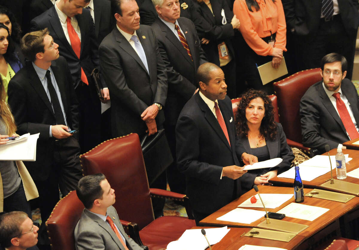 Senator Malcolm A. Smith, center, speaks during a vote last week on the NY SAFE Act bill, Monday night, Jan. 14, 2013 in Albany, N.Y. (Lori Van Buren / Times Union)