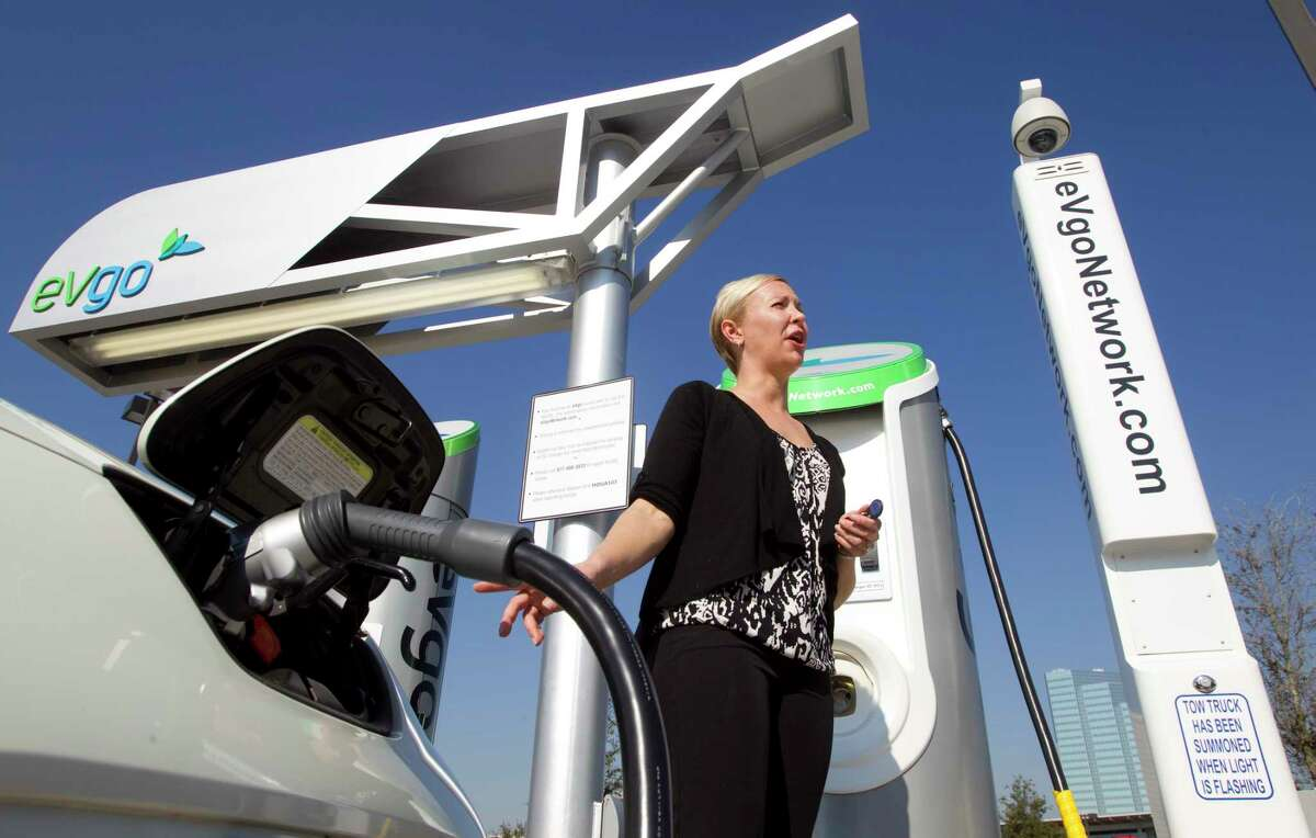 Carly Kade, communications for eVgo, stands near the eVgo charging station located in the HEB in the 5200 block of Buffalo Speedway Tuesday, Jan. 22, 2013, in Houston. ( Brett Coomer / Houston Chronicle )