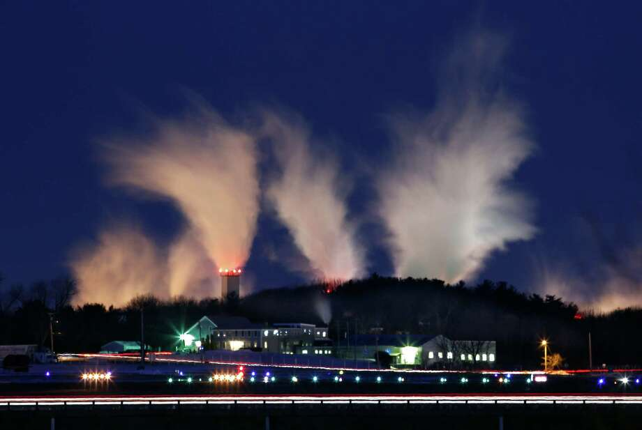 With the temperature at minus 6 degrees Fahrenheit, steam vapors from the Sappi paper mill dissipate into the early morning sky  in Westrbook, Maine, Thursday morning, Jan. 24, 2013.  An arctic cold front continues to grip the region. Photo: Robert F. Bukaty, Associated Press / AP