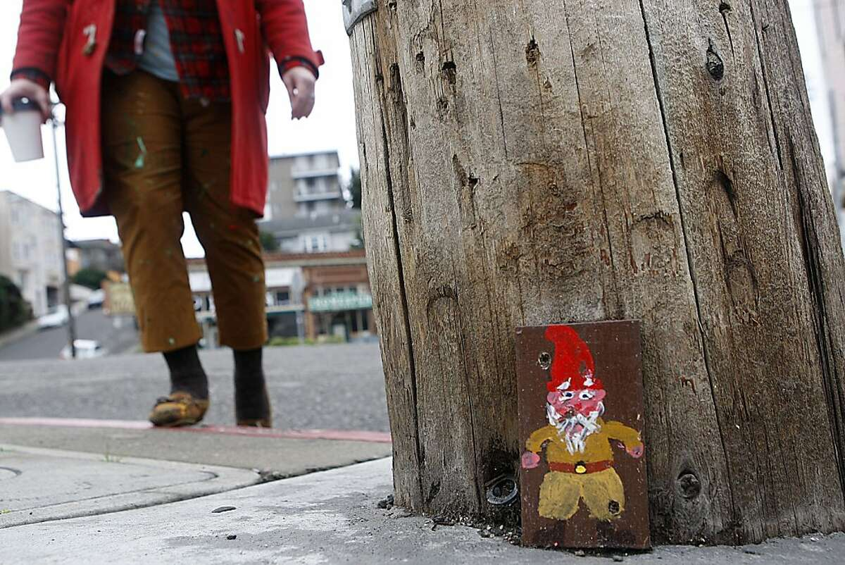 Shannon Taylor, art director at Fairyland, shows places around Oakland, Calif., where gnomes have been placed including this telephone pole on Newton and Wesley avenues on Thursday, January 24, 2013.
