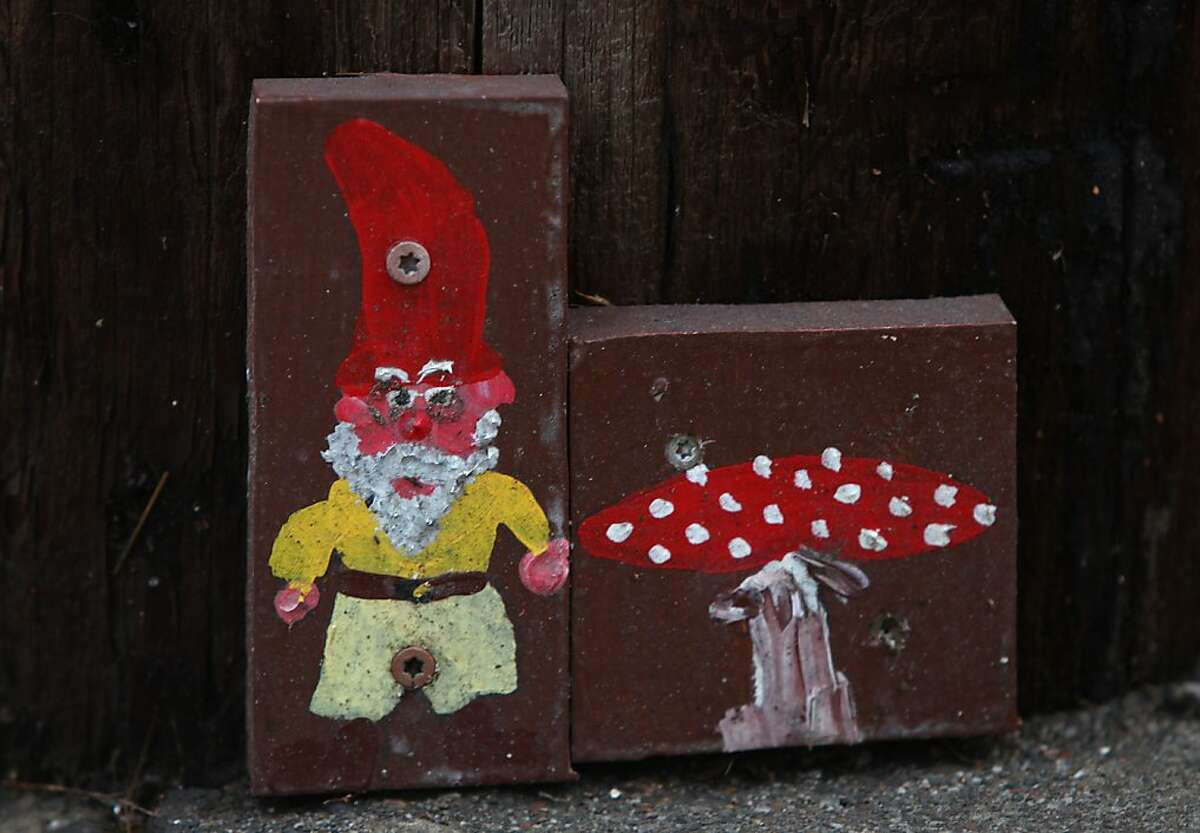 A gnome and mushroom screwed onto a telephone pole on Newton Avenue. in Oakland, Calif., on Thursday, January 24, 2013.