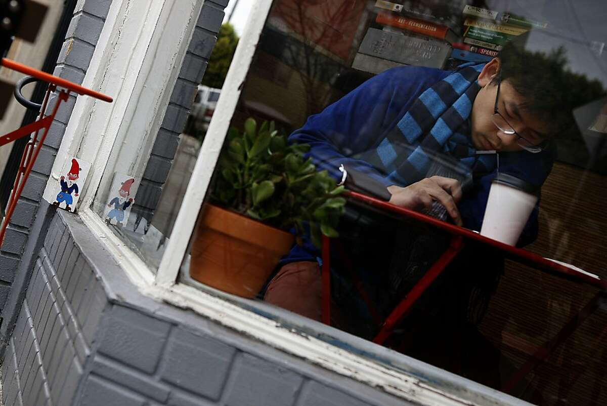 Benny Yu (right) having coffee at Haddon Hill cafe in Oakland, Calif., as a gnome sits on a window sill (left) on Thursday, January 24, 2013.
