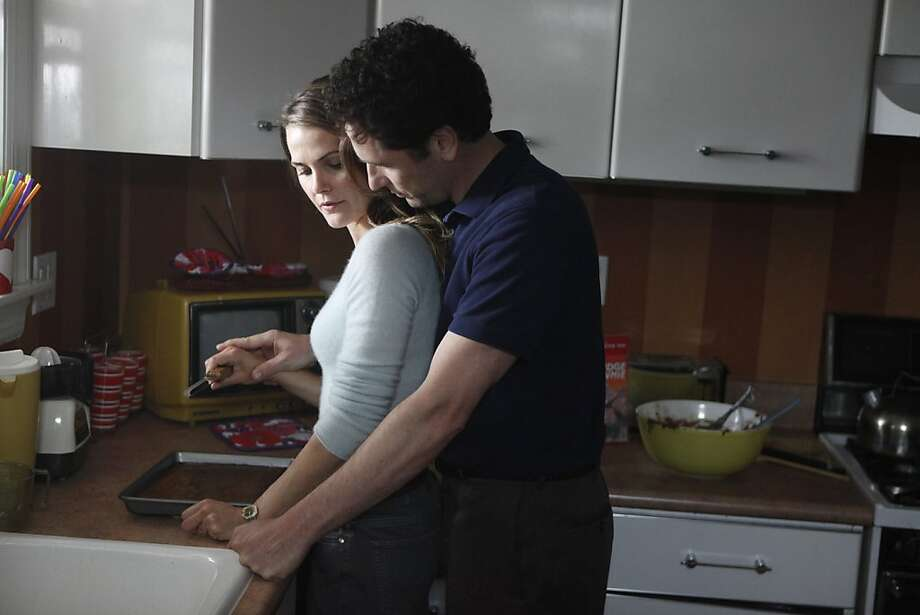"Keri Russell and Matthew Rhys are married-withchildren Russian spies in ""The Americans."" Photo: Craig Blankenhorn, FX"