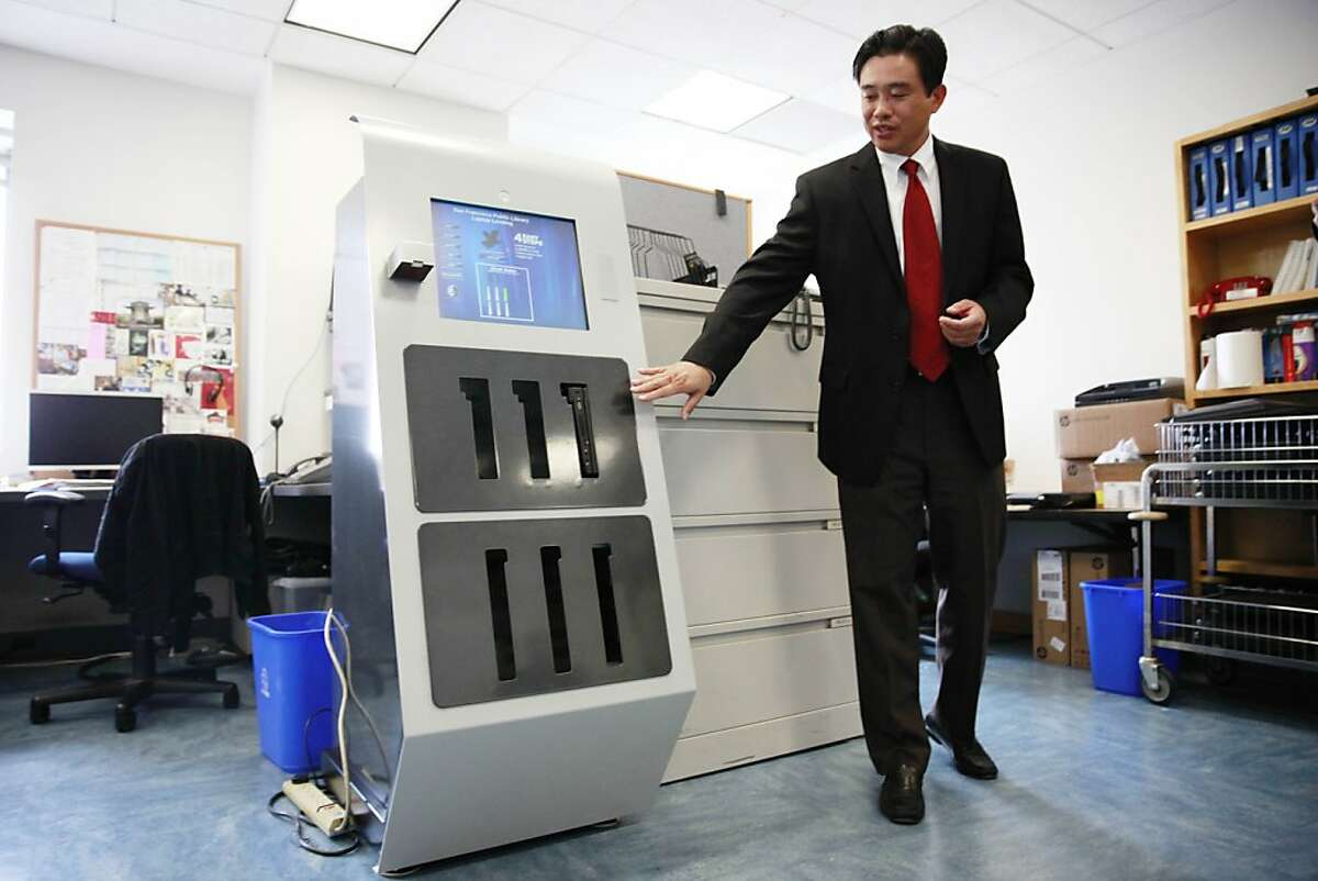 Michael Liang, chief information officer San Francisco Public Library, stands next to a trial version of an electronic kiosk in the IT office at the Main Library on Thursday, January 24, 2013 in San Francisco, Calif.